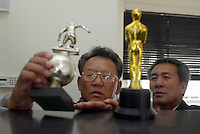2 MEMEBERS OF THE NORTH KOREAN WORLD CUP TEAM OF 1966 LOOK AT THE THROPHIES WON BY THE DANIEL'S GORDON FILM (THE GREATEST GAME OF THEIT LIFE) IN THE OFFICE OF THE FILM PRODUCTION COMPANY- PICTURE  BY MARCELLO POZZETTI FOR THE TIMES NEWSPAPERS- MARCELLO POZZETTI 21 DELISLE ROAD LONDON SE28 0JD=TEL 02088551008 - FAX: 02088551937 - MOBILE 07973308835