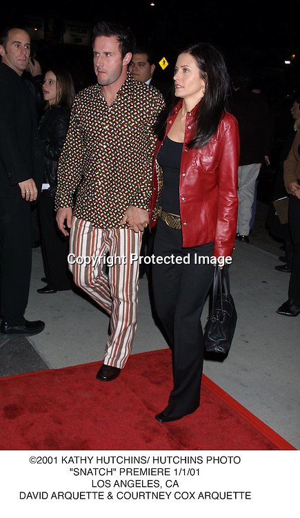 "©2001 KATHY HUTCHINS/ HUTCHINS PHOTO.""SNATCH"" PREMIERE 1/1/01.LOS ANGELES, CA.DAVID ARQUETTE & COURTNEY COX ARQUETTE"