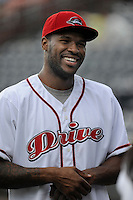 Former Clemson University basketball star Trevor Booker, now with the NBA's Washington Wizards, threw out the first pitch before a game between the Charleston RiverDogs and the Greenville Drive on Wednesday, June 11, 2014, at Fluor Field at the West End in Greenville, South Carolina. (Tom Priddy/Four Seam Images)