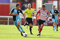 Lee Holmes of Exeter City picks a pass under pressure from Luke O'Nien of Wycombe Wanderers during the Sky Bet League 2 match between Exeter City and Wycombe Wanderers at St James' Park, Exeter, England on 26 September 2015. Photo by Pinnacle Photo Agency.