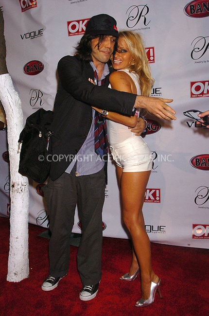 WWW.ACEPIXS.COM . . . . . ....MIAMI, AUGUST 26, 2005....Pamela Anderson at the Vogue Eyewear and Bang Vodka's Star Struck Party held at the Style Villa at Sagamore Hotel.....Please byline: AJ SOKALNER - ACE PICTURES.. . . . . . ..Ace Pictures, Inc:  ..Craig Ashby (212) 243-8787..e-mail: picturedesk@acepixs.com..web: http://www.acepixs.com
