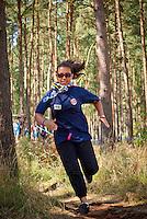 A Norwegian Girl is running through Conquest . Photo: André Jörg/ Scouterna