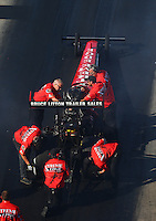 Jun 17, 2016; Bristol, TN, USA; Crew members with NHRA top fuel driver Kyle Wurtzel during qualifying for the Thunder Valley Nationals at Bristol Dragway. Mandatory Credit: Mark J. Rebilas-USA TODAY Sports