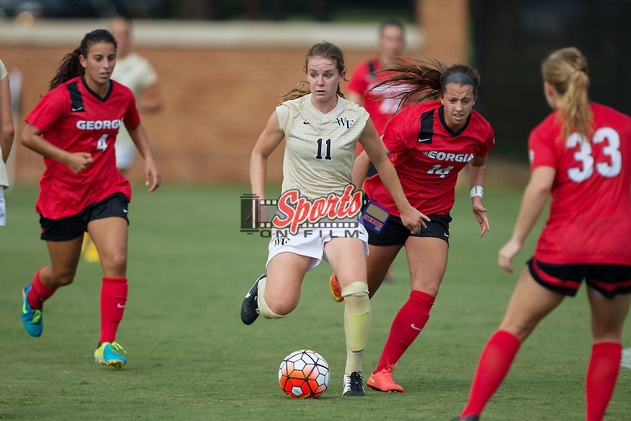 Maddie Huster (11) of the Wake Forest Demon Deacons controls the ball while surrounded by Georgia Bulldogs defenders during first half action at Spry Soccer Stadium on August 23, 2015 in Winston-Salem, North Carolina.  The Deacons defeated the Bulldogs 4-0.  (Brian Westerholt/Sports On Film)