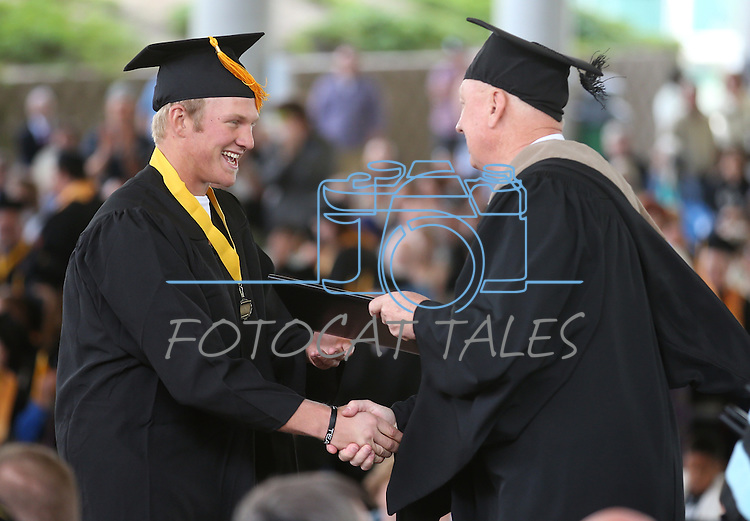 Interim President Chester Burton congratulates Jake Bennett during the Western Nevada College commencement at the Pony Express Pavilion, in Carson City, Nev., on Monday, May 19, 2014. <br />