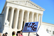 Washington, DC - January 19, 2018: A woman holds a  sign in front of the U.S. Supreme Court as tens of thousands of people participate in the annual March for Life in Washington, D.C. January 19, 2018.  (Photo by Don Baxter/Media Images International)