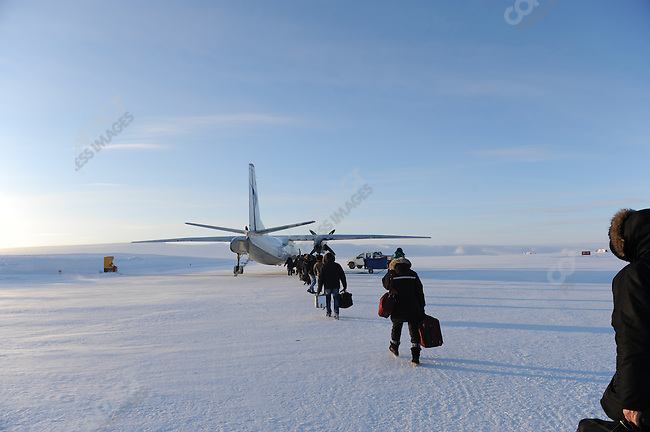 At the Kupol gold mine in Chukotka operated by the Canadian company Kinross, workers walked out to one of the daily flights to Magadan which brings workers in and out of the mine. Russian Far East, February 8, 2011
