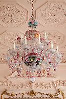 Underneath the lavish, leafy scrolls of a rococo celing hangs an extravagant eighteenth century Murano chandelier