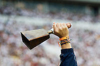 Cowbell ringing during football game (photo by Megan Bean / © Mississippi State University)