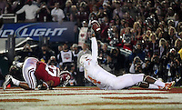 Jan 7, 2010; Pasadena, CA, USA; Texas Longhorns wide receiver Dan Buckner (4) holds up the football after making a catch for a two-point conversion during the fourth quarter of the 2010 BCS national championship game at the Rose Bowl.  Mandatory Credit: Mark J. Rebilas-