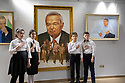 Uzbekistan - Tashkent - Uzbek pupils stand next to a painting of Karimov, former president of Uzbekistan who died in 2016 after ruling for 25 years with an iron fist.