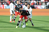 WASHINTON, DC - FEBRUARY 29: Washington, D.C. - February 29, 2020: Russell Canouse #4 of D.C. United battles the ball with Andre Shinyashiki #99 of the Colorado Rapids. The Colorado Rapids defeated D.C. United 2-1 during their Major League Soccer (MLS)  match at Audi Field during a game between Colorado Rapids and D.C. United at Audi FIeld on February 29, 2020 in Washinton, DC.