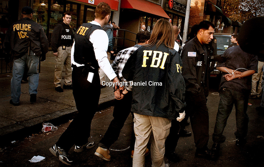 FBI and ICE police apprehending illegal .workers in Washington DC