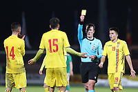 19th November 2019; Ballymena Showgrounds, Ballymena, Antrim County, Northern Ireland; European Under 21 Championships 2021 Qualifier, Northern Ireland Under 21 versus Romania Under 21; Romania's Andrei Chindris receives his second yellow card of the game from referee Referee K. E. Steen (NOR)  - Editorial Use