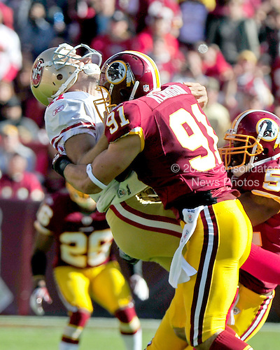 San Francisco 49ers quarterback Alex Smith (11) is sacked by Washington Redskins linebacker Ryan Kerrigan (91) in first quarter action at FedEx Field in Landover, Maryland on Sunday, November 6, 2011..Credit: Ron Sachs / CNP