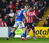 Lincoln City's Bruno Andrade vies for possession with Macclesfield Town's James Pearson<br /> <br /> Photographer Andrew Vaughan/CameraSport<br /> <br /> The EFL Sky Bet League Two - Lincoln City v Macclesfield Town - Saturday 30th March 2019 - Sincil Bank - Lincoln<br /> <br /> World Copyright © 2019 CameraSport. All rights reserved. 43 Linden Ave. Countesthorpe. Leicester. England. LE8 5PG - Tel: +44 (0) 116 277 4147 - admin@camerasport.com - www.camerasport.com