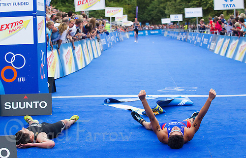 25 JUL 2010 - LONDON, GBR - Javier Gomez celebrates victory ahead of Jonathan Brownlee (left) in the mens race of the London round of the ITU World Championship Series triathlon .(PHOTO (C) NIGEL FARROW)