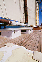 A chart is spread out on top of the cabin on a tall ship sailing vessel sailing in Sturgeon Bay, Wisconsin