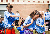 NWA Democrat-Gazette/CHARLIE KAIJO Drew Lawrence, 11, (from left) throws a water balloon at Sami Lawrence, 9, during a STEM camp, Monday, June 11, 2018 at Bonnie Grimes Elementary School in Rogers.<br />