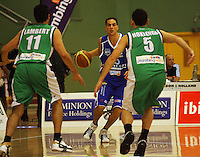 Troy McLean looks to get past Stacey Lambert and Kaine Hokianga during the NBL Round 14 match between the Manawatu Jets  and Wellington Saints. Arena Manawatu, Palmerston North, New Zealand on Saturday 31 May 2008. Photo: Dave Lintott / lintottphoto.co.nz