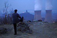 Man morning Exercising near a thermal power factory in Beijing, China. Beijing is taking more steps to clean up its air ahead of the summer Olympics. Several temporary measures include stopping construction and closing heavy-polluting plants..18 Feb 2008