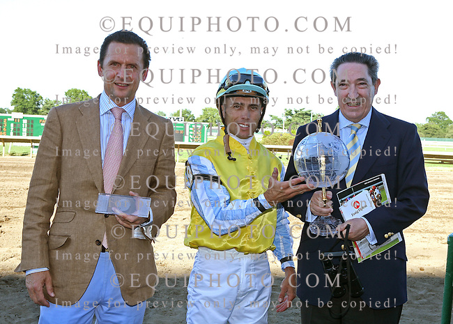 (L to R)Trainer Carlos Laffon-Parias, Jockey Garrett Gomez and  Owner Dario Hinojosa hold the United Nations Stakes Trophy after Chinchon won the $750,000 Grade 1 Betfair/TVG United Nations Stakes at Monmouth Park on Saturday July 3, 2010.  Photo By Bill Denver/EQUI-PHOTO.
