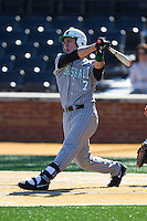 Chase Vogelbach (7) of the Marshall Thundering Herd follows through on his swing against the Georgetown Hoyas at Wake Forest Baseball Park on February 15, 2014 in Winston-Salem, North Carolina.  The Thundering Herd defeated the Hoyas 5-1.  (Brian Westerholt/Four Seam Images)