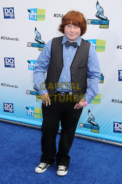 Tucker Albrizzi.The 2012 Do Something Awards at the Barker Hangar in Santa Monica, California, USA..August 19th, 2012.full length blue shirt grey gray waistcoat black trousers bow tie.CAP/ADM/BP.©Byron Purvis/AdMedia/Capital Pictures.