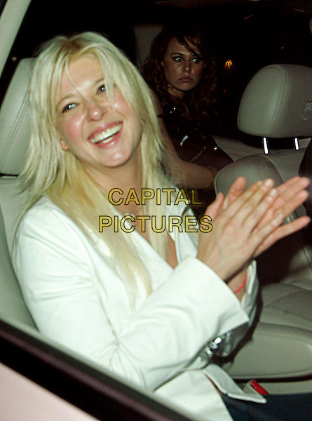 TARA REID.Spotted at Hyde Lounge located on Sunset Boulevard,.West Hollywood, California, Los Angeles, USA, .26 August 2006..half length heart necklace white jacket  in car drunk? funny hands.Ref: ADM/JL.www.capitalpictures.com.sales@capitalpictures.com.©Jackson Lee/AdMedia/Capital Pictures.
