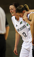 Kate McMeeken-Ruscoe carries injured Tall ferns forward Pip Connell off during the International women's basketball match between NZ Tall Ferns and Australian Opals at Te Rauparaha Stadium, Porirua, Wellington, New Zealand on Monday 31 August 2009. Photo: Dave Lintott / lintottphoto.co.nz