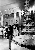 Washington, DC - June 12, 1971 -- Newlyweds Edward Cox and Tricia Nixon Cox prepare to cut the huge wedding cake in the White House following their wedding in the Rose Garden of the White House in Washington, D.C. on Saturday, June 12, 1971..Credit: Pool via CNP