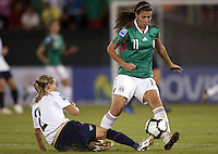 Heather Mitts (2) of USA and Lydia Rangel (11)of Mexico during the semifinal match of CONCACAF Women's World Cup Qualifying tournament held at Estadio Quintana Roo in Cancun, Mexico. Mexico 2, USA 1.