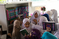 January 13, 2015 - Puchong, Kuala Lumpur (Malaysia). Young female daughters of Ikhwan members put back their books after a class of Koran at the Sekolah Menengah Islam Global Ikhwan school in Puchong. In the school they also study arabics and follow practical workshops learning how to cook, clean or take care of babies. © Thomas Cristofoletti / Ruom