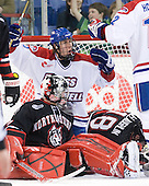 Michael Budd (Lowell - 18) celebrates his second goal of the game which gave Lowell a 2-1 lead in the second period. - The visiting Northeastern University Huskies defeated the University of Massachusetts-Lowell River Hawks 3-2 with 14 seconds remaining in overtime on Friday, February 11, 2011, at Tsongas Arena in Lowelll, Massachusetts.