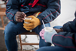 Two African migrants take hot milk sheltered from the cold. Irun (Basque Country). November 1, 2018. A group of volunteers has created a host network to serve migrants and inform about the public services they are entitled to and the ways to cross the border. This group of volunteers is avoiding a serious humanitarian problem Irun, the Basque municipality on the border with Hendaye. As the number of migrants arriving on the coasts of southern Spain incresead, more and more migrants are heading north to the border city of Irun. French authorities have reacted by conducting random checks as far as the city of Bordeaux, more than 200 kilometers north of the border. Migrants who are caught are then deported back to Irun. (Gari Garaialde / Bostok Photo).