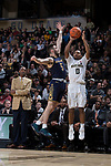 Brandon Childress (0) of the Wake Forest Demon Deacons shoots over Matt Farrell (5) of the Notre Dame Fighting Irish as head coach Danny Manning looks on during second half action at the LJVM Coliseum on February 24, 2018 in Winston-Salem, North Carolina. The Fighting Irish defeated the Demon Deacons 76-71.  (Brian Westerholt/Sports On Film)
