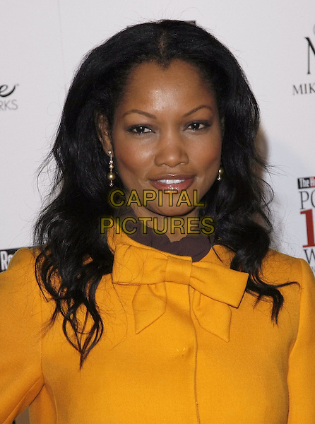 GARCELLE BEAUVAIS-NILON .at The Hollywood Reporter's Annual Women in Entertainment Breakfast held at The Beverly Hills Hotel in Beverly Hills, California, USA, .December 5th 2008.                                                                     .portrait headshot bright yellow coat bow.CAP/DVS.©Debbie VanStory/Capital Pictures