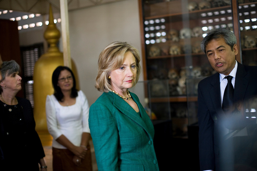 US Secretary of State Hillary Clinton looks at the skulls of victims of the Khmer Rouge during a personal tour of Tuol Sleng genocide museum, also known as S-21, in Phnom Penh, Cambodia, November 1, 2010. The Secretary of State was in Cambodia on a 2-day visit.