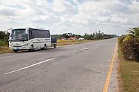 Cuba, Pinar del Rio Region, Viñales (Vinales) Area.  Highway A4.  Modern Tourist Bus Stops Opposite a Highway Rest Stop.