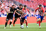 Angel Correa of Atletico de Madrid (C) fights for the ball with David Lomban of SD Eibar (L) during the La Liga match between Atletico Madrid and Eibar at Wanda Metropolitano Stadium on May 20, 2018 in Madrid, Spain. Photo by Diego Souto / Power Sport Images