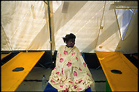 Luanda, Angola, May 20, 2006.Lorina, 18, is a patient at the Cacuaco MSF Belgium operated cholera field clinic. Between February and June 2006, more than 30000 people were infected with cholera in Angola's worse outbreak ever; more than 1300 died..Just 4 years after the end of a 25 year long civil war, Angola is starting to emerge again, yet a lot remains to be done: entire regions are still cut-off from the ouside world because of landmines and broken bridges, over 80% of the population lives below the poverty threshold in one of the potentially richest country in Africa. Natural ressources include oil, diamonds, gold and...water!.Malaria, tuberculosis, HIV/Aids are endemic, cholera and meningitis frequent.
