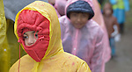 A refugee child walks through the rain to approach the border into Croatia near the Serbian village of Berkasovo. Hundreds of thousands of refugees and migrants from Syria, Iraq and other countries--including many children--have flowed through Serbia in 2015, on their way to western Europe.