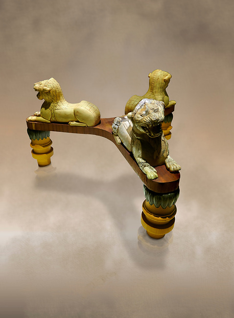 Phrygian table base support decorated with ivory roaring lion statuettes. From Gordion. Phrygian Collection, 8th-7th century BC - Museum of Anatolian Civilisations Ankara. Turkey. Against an art background