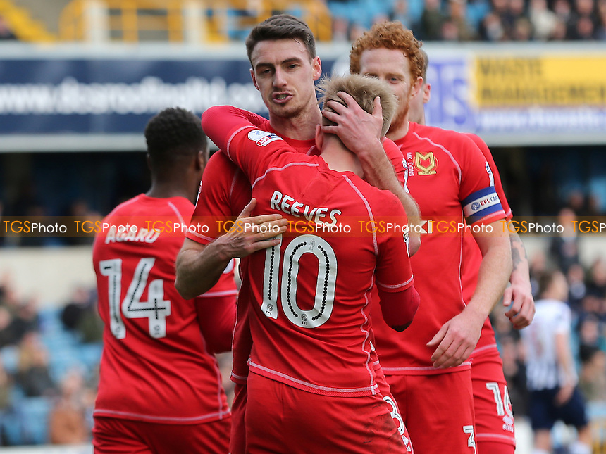 Darren Potter congratulates Ben Reeves after scoring MK Dons opening goal during Millwall vs MK Dons, Sky Bet EFL League 1 Football at The Den on 4th March 2017