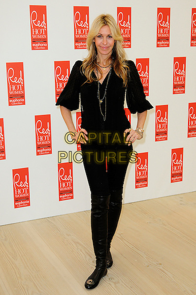 MELISSA ODABASH .attends Red magazine's 'Red Hot Women Awards' at the Saatchi Gallery, London, England, UK, .November 30th 2010..full length black top hands on hips gold necklace bracelets  blouse flats shoes flat .CAP/CAS.©Bob Cass/Capital Pictures.