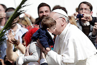 Papa Francesco celebra la messa per la Domenica delle Palme in Piazza San Pietro, Citta' del Vaticano, 24 marzo 2013..Pope Francis kisses a baby at the end of the Palm Sunday Mass in St. Peter's square at the Vatican, 24 March 2013..UPDATE IMAGES PRESS/Riccardo De Luca..STRICTLY ONLY FOR EDITORIAL USE