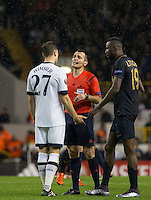 Referee Referee Ivan Bebek talks to Kevin Wimmer of Tottenham Hotspur & Lacina Traore of Monaco during the UEFA Europa League group match between Tottenham Hotspur and Monaco at White Hart Lane, London, England on 10 December 2015. Photo by Andy Rowland.