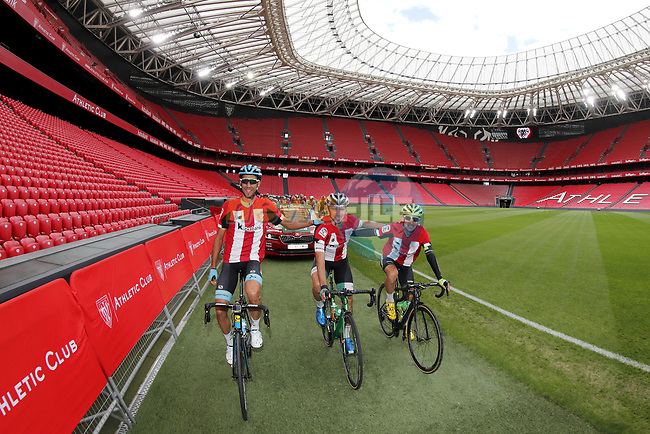 Omar Fraile Matarranz (ESP) Astana, Jonathan Lastra Martinez (ESP) Caja Rural-Seguros RGA and Mikel Bizkarra (ESP) Euskadi-Murias dressed in the club kit lead out the start of Stage 13 of La Vuelta 2019 starting in Athletic Club Bilbao's Estadio de San Mames and running 166.4km from Bilbao to Los Machucos, Spain. 6th September 2019.<br /> Picture: Luis Angel Gomez/Photogomezsport | Cyclefile<br /> <br /> All photos usage must carry mandatory copyright credit (© Cyclefile | Luis Angel Gomez/Photogomezsport)