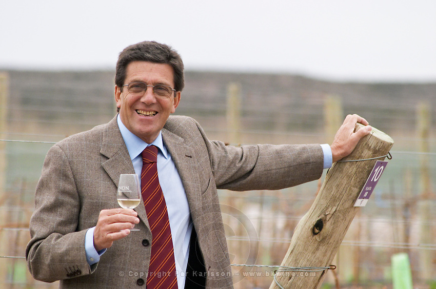 Luis Maria Focacci, managing partner and owner, with a glass of wine in the vineyard. Bodega NQN Winery, Vinedos de la Patagonia, Neuquen, Patagonia, Argentina, South America