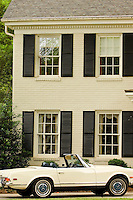 A car is parked outside of a home in the Myers Park neighborhood in Charlotte, NC. Myers Park is one of the premier neighborhoods in North America and known for its large canopy of trees.